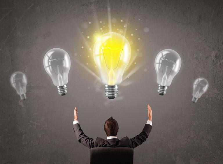 Business person having an bright idea light bulb concept