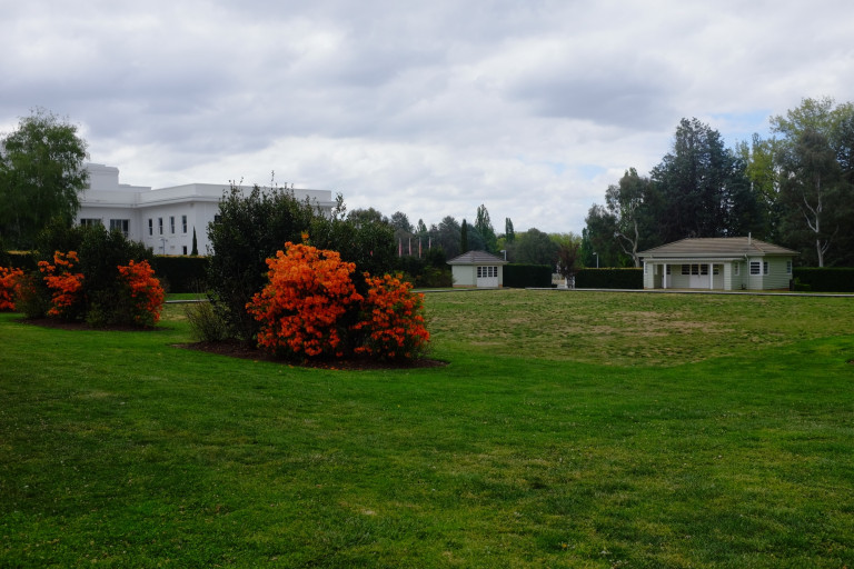 old parliament house of representatives garden with parliament building in background
