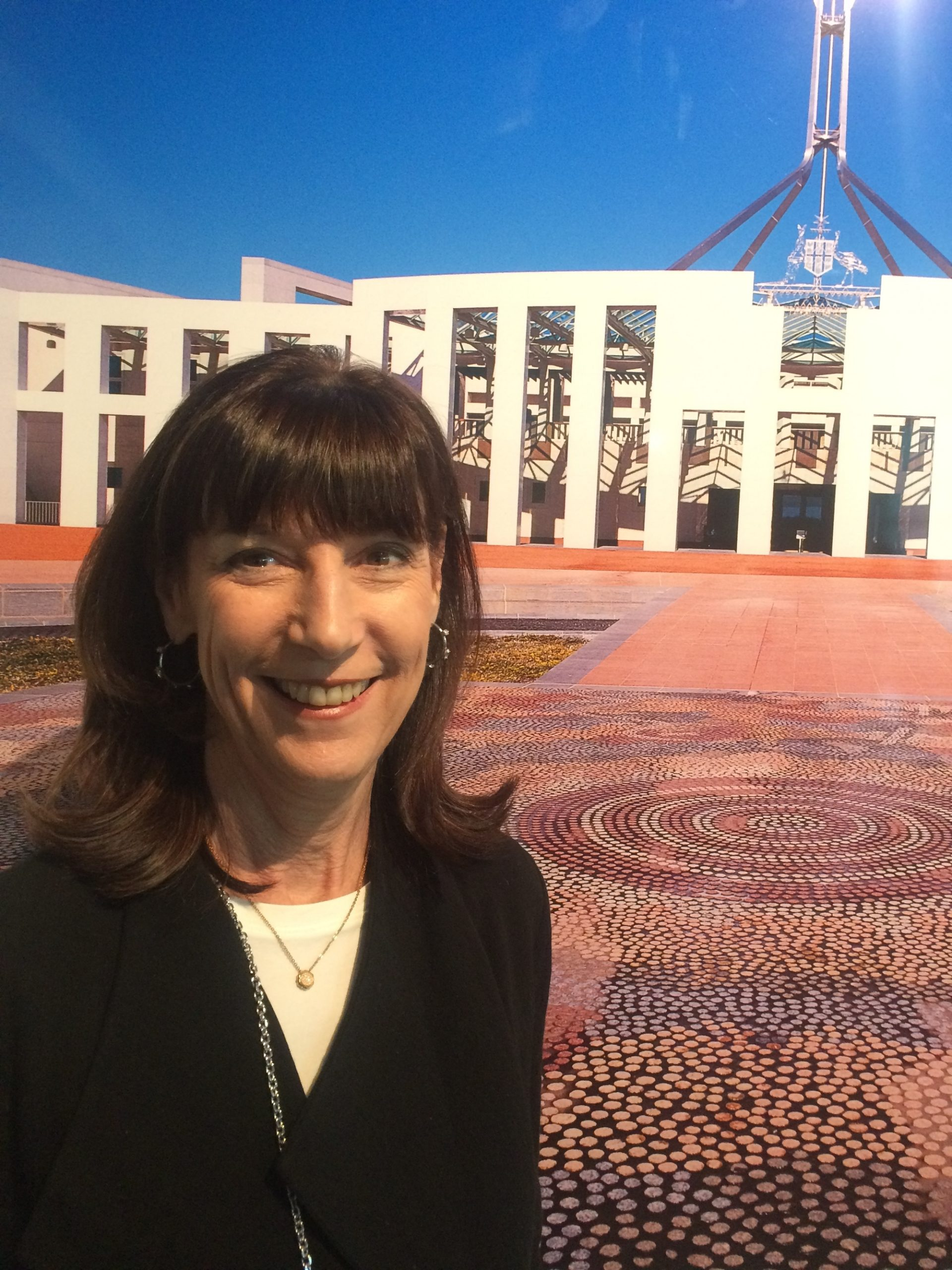 karenne, on forecourt mosiac, with parliament house in background