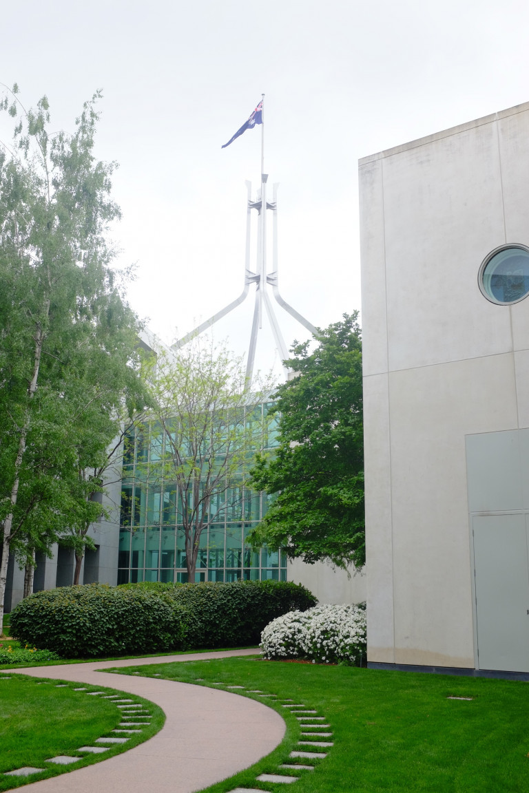 view of parliament house from inside one of the private courtyards