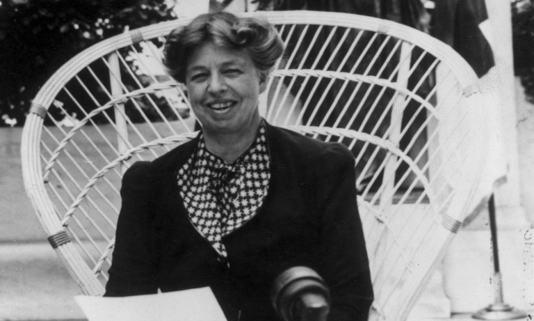 photo of eleanor Roosevelt sitting in a cane chair