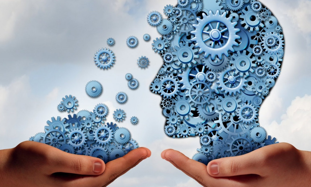 two hands with graphic cogs forming human head