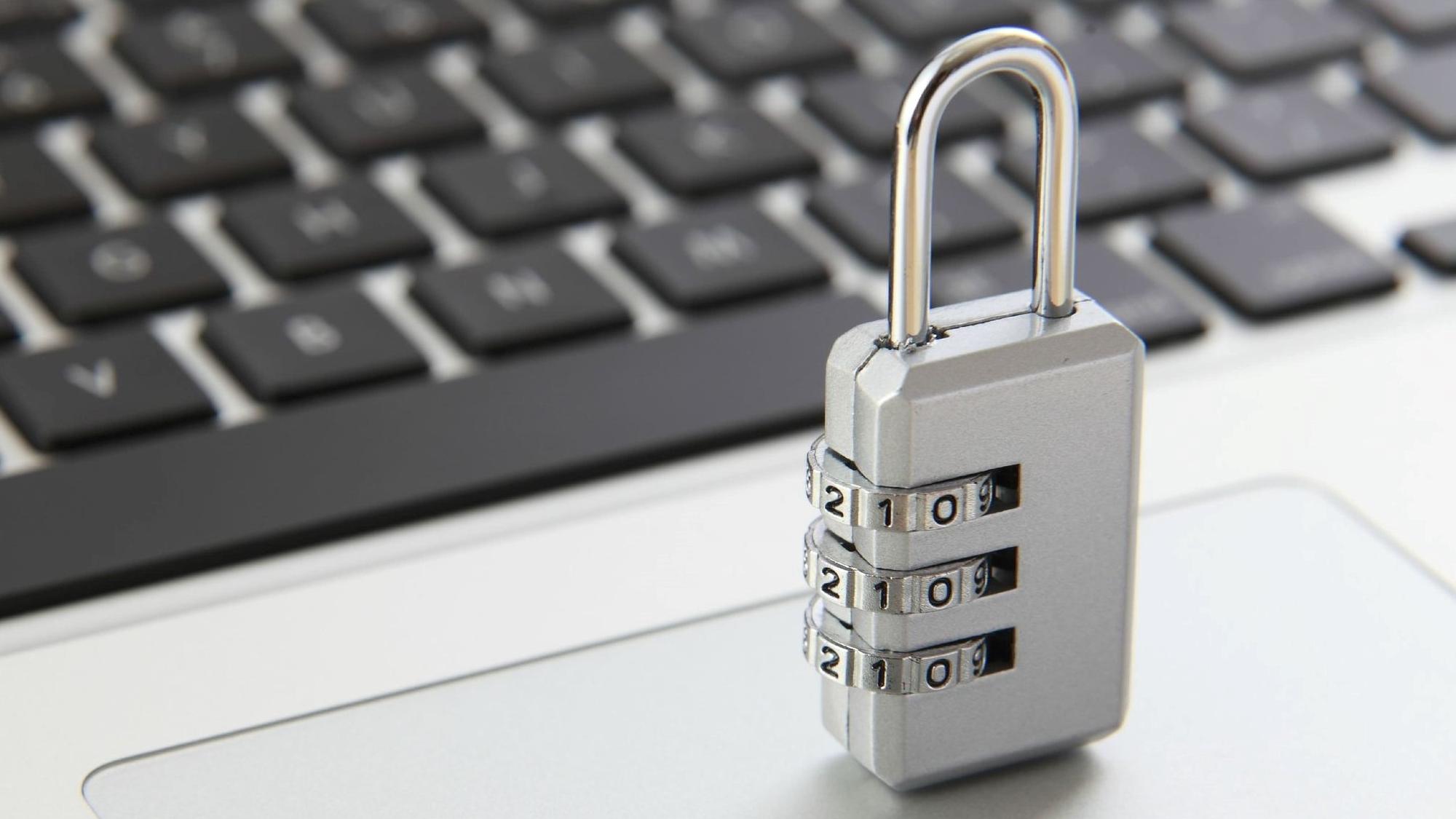 a padlock on laptop keyboard