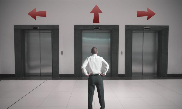 man deciding between three lift doors