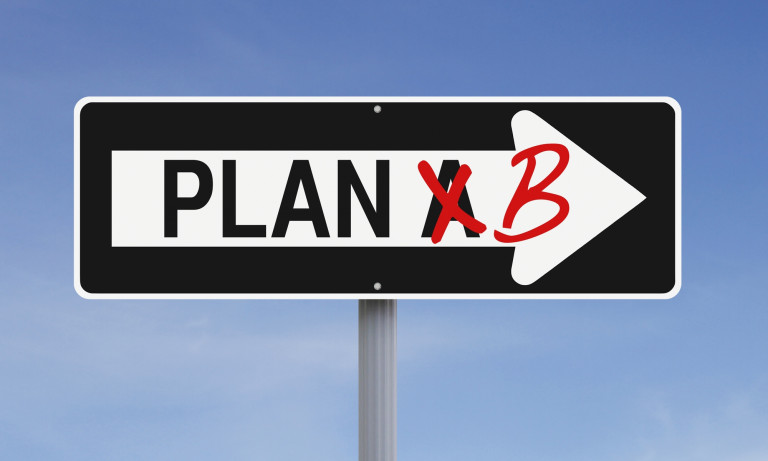 roadsign showing plan A crossed out and replaced by plan A
