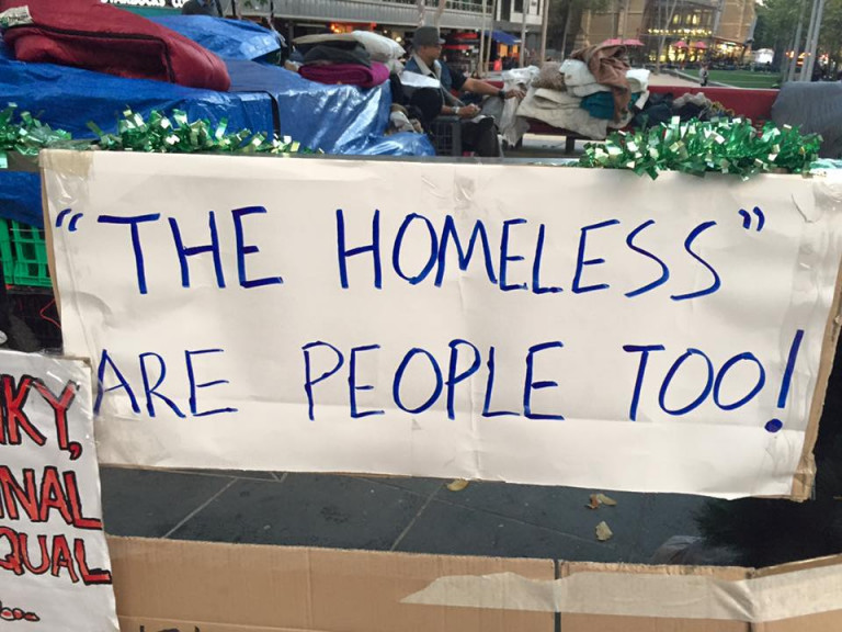 protest banner with the words the homeless are people too